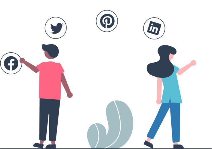 Man and woman selecting social media icons